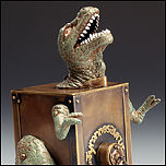 pinhole camera made from a brass box and a plastic dinosaur by Judith Hoffman